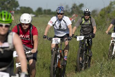 Riders make their way on the first day of their 100-kilometer ride at former President George W. Bush's ranch near Crawford on May 1, 2015.