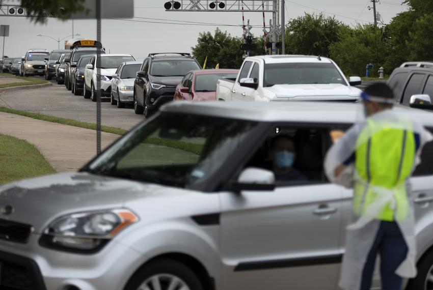 A line of about 100 cars formed at Barbara Jordan Elementary School in Austin at a COVID-19 testing site. June 26, 2020.