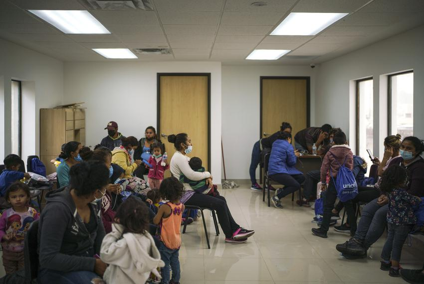 Migrants that were flown from Brownsville and deported to Ciudad Juarez in Mexico waited at the Juarez Migrant Assistance Ce…