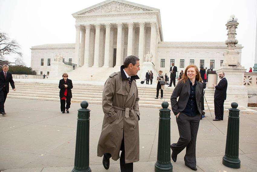 Abigail Fisher, right, plaintiff in Fisher v. University of Texas, leaves the U.S. Supreme Court with Edward Blum of the P...