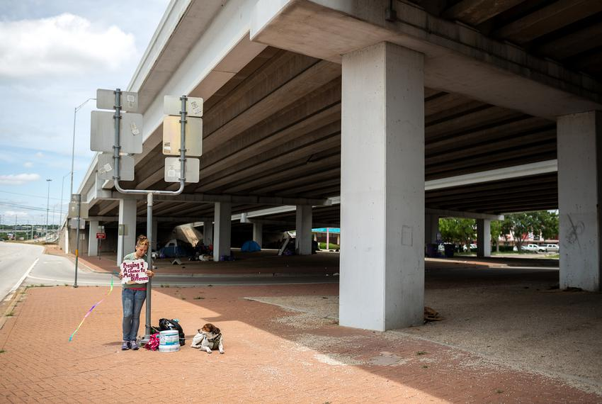 Recently released from jail, Rachel Schuyler panhandles with her dog, Kaido, near the interesection of Burnet Road and U.S...
