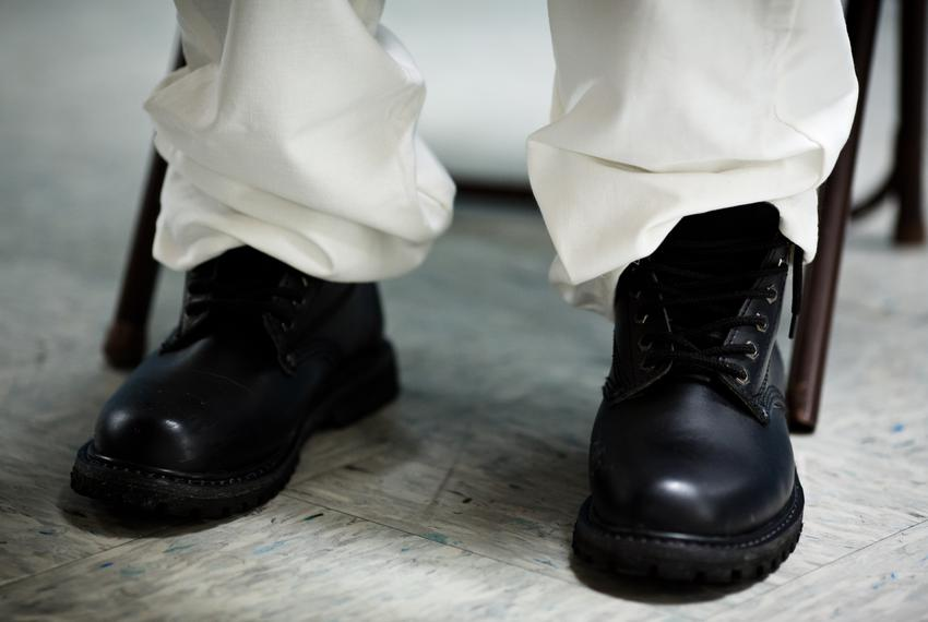The shoes of a convicted pimp who is serving out his sentence in a Texas prison. Pimps say they use fear and shame to control their victims.
