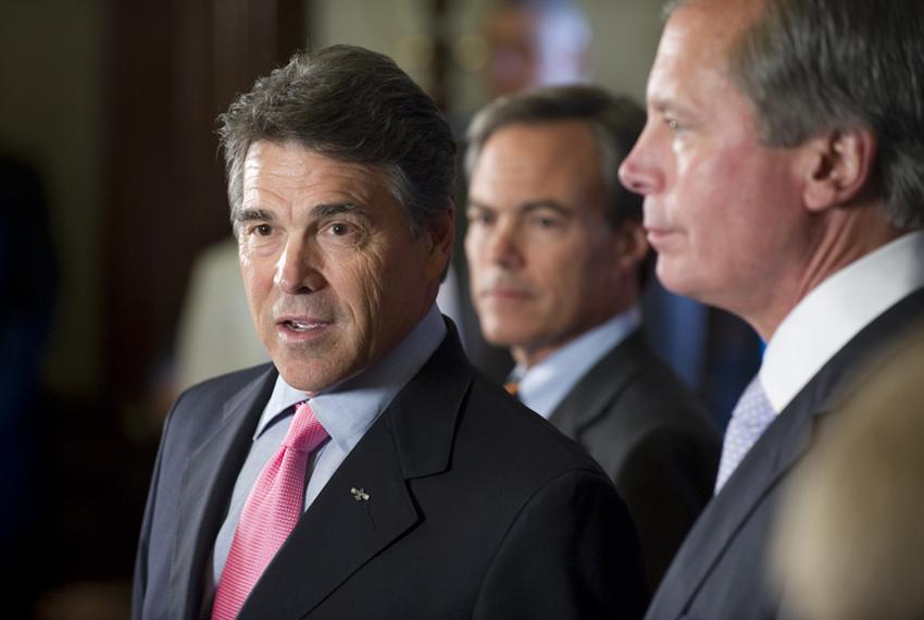 Gov. Rick Perry speaking to reporters alongside House Speaker Joe Straus, center, and Lt. Gov. David Dewhurst during a post-…