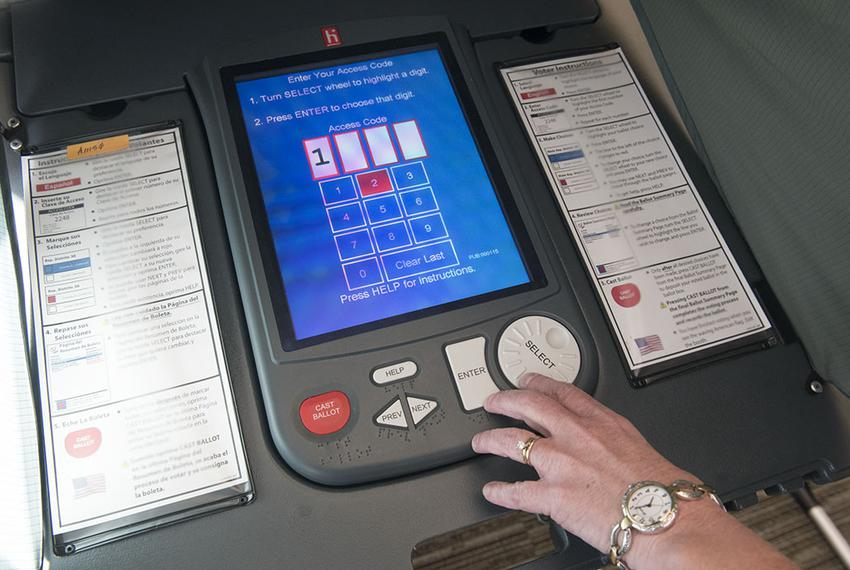An election judge in south Texas tests a voting machine for accuracy after the end of voting hours on Oct. 26, 2016.