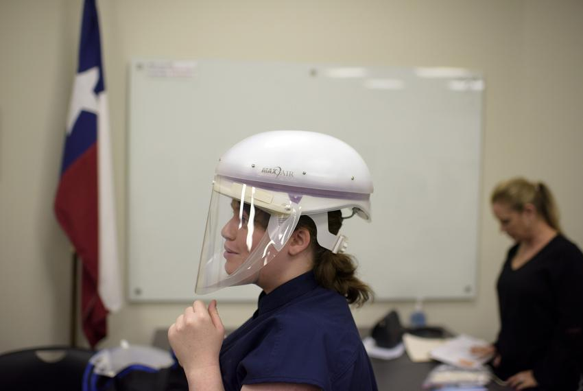 Danielle Teran, an infection control practitioner, wears a face mask during a personal protection equipment training sessi...