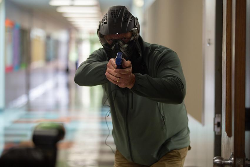 An educator partakes in a simulated shooting as part of a training for school marshals. School marshals are school staff t...
