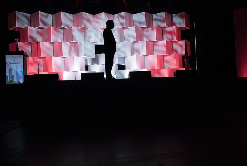 U.S. Sen. Ted Cruz stands silhouetted onstage as he waits to deliver his speech to delegates at the Republican Party of Texa…