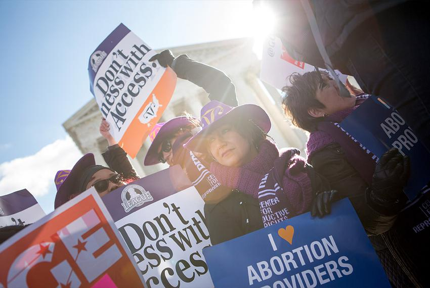 Lara Chelian, center, and her mother, Renee Chelian, both abortion providers from Michigan, hold signs in front of the U.S. …