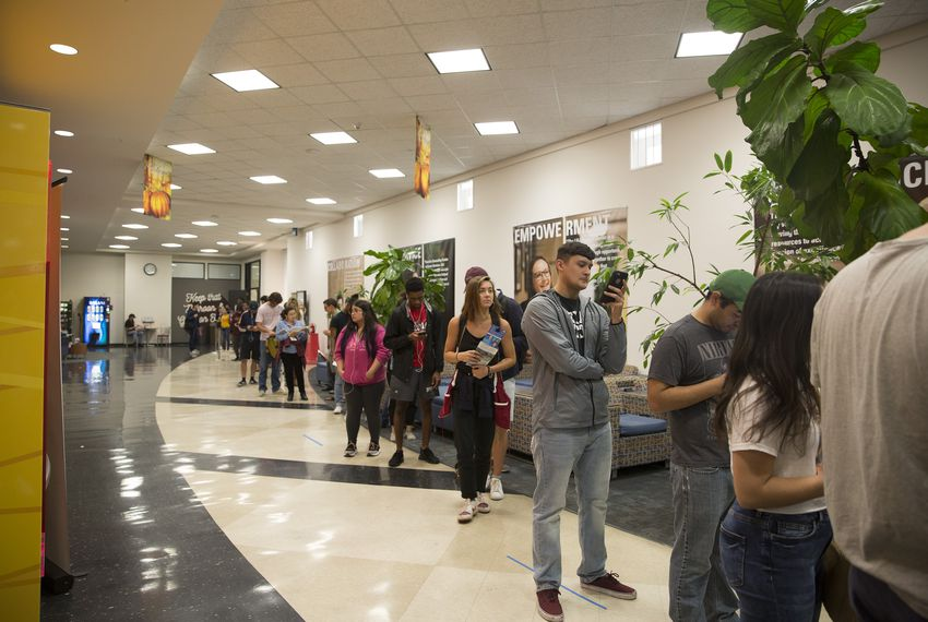 Voters line up to cast their ballot at the LBJ Student Center at Texas State University on Friday, Nov. 2, 2018.