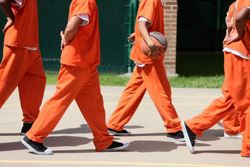 Detainees line up to leave the outdoor recreation area at theTravis County Juvenile Detention Center in Austin on June 24, 2013.