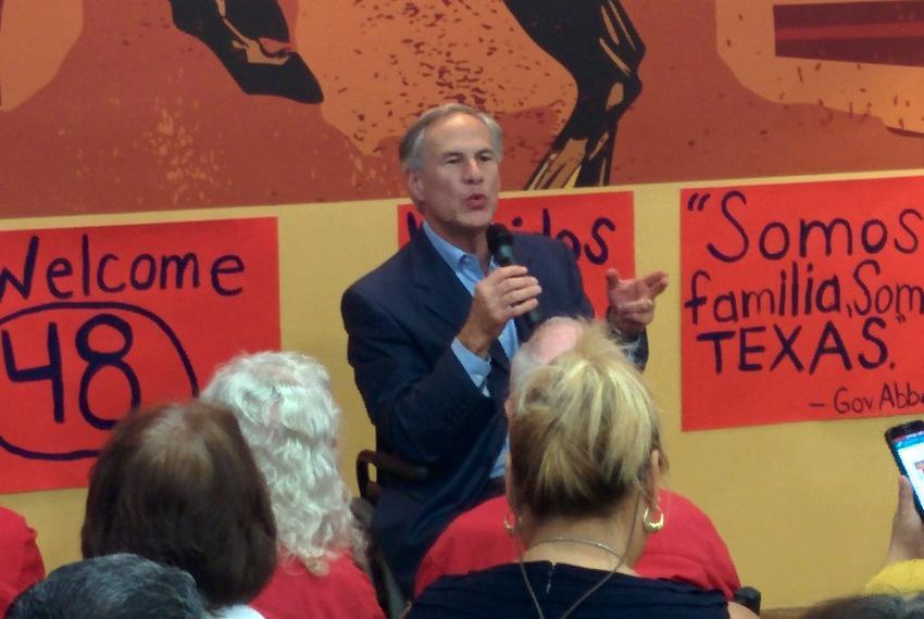 Gov. Greg Abbott spoke to a crowd at the Cowboy Chicken restaurant in McAllen, Texas, on Sept. 16, 2015.