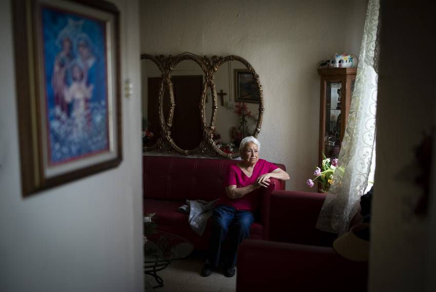 Antonita Morales sits in her living room in the Duranguito neighborhood in El Paso. Morales has lived in the neighborhood since 1965 and is the last resident living in her apartment complex.