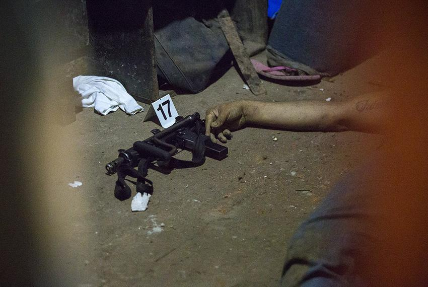 The body of an alleged gang member following a shootout in Ayagualo, El Salvador, in May 2016 that police say began when one…