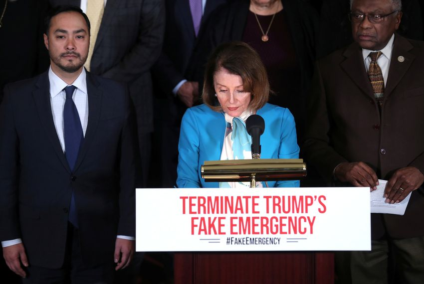 U.S. House Speaker Nancy Pelosi, flanked by House Democrats including U.S. Rep. Joaquin Castro, D-San Antonio (left), held a news conference Monday about the proposed resolution to terminate President Donald Trump's emergency declaration.