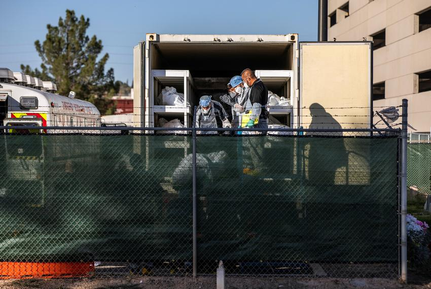 "El Paso County detention inmates, also known as ""trustees"" who are low-level offenders, help move bodies to mobile morgue un…"