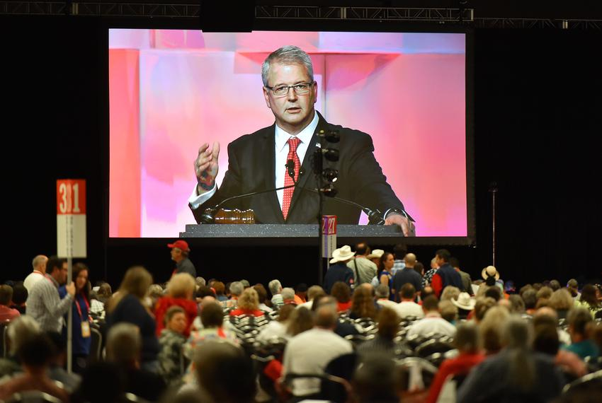James Dickey, Texas GOP Chairman is seen on a large video screen during the final afternoon of the 2018 Texas GOP Convention…