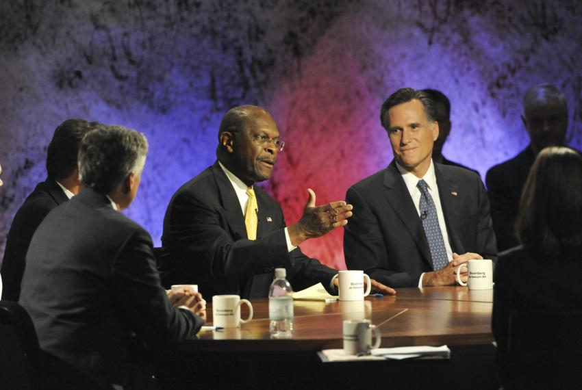 Republican presidential candidates Herman Cain and Mitt Romney at the Dartmouth College Republican debate on Oct. 11, 2011.
