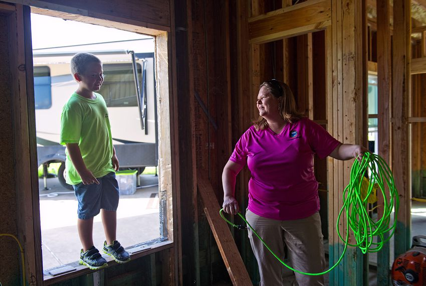 Danielle Hale and her son, Conner, 8 help friends rebuild their home damaged by Hurricane Harvey, on August 11, 2018.