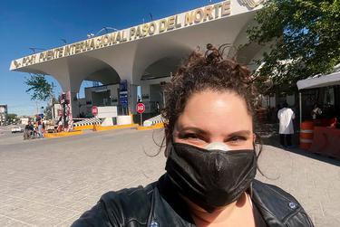 Taylor Levy stands near the international bridge connecting El Paso and Ciudad Juárez.