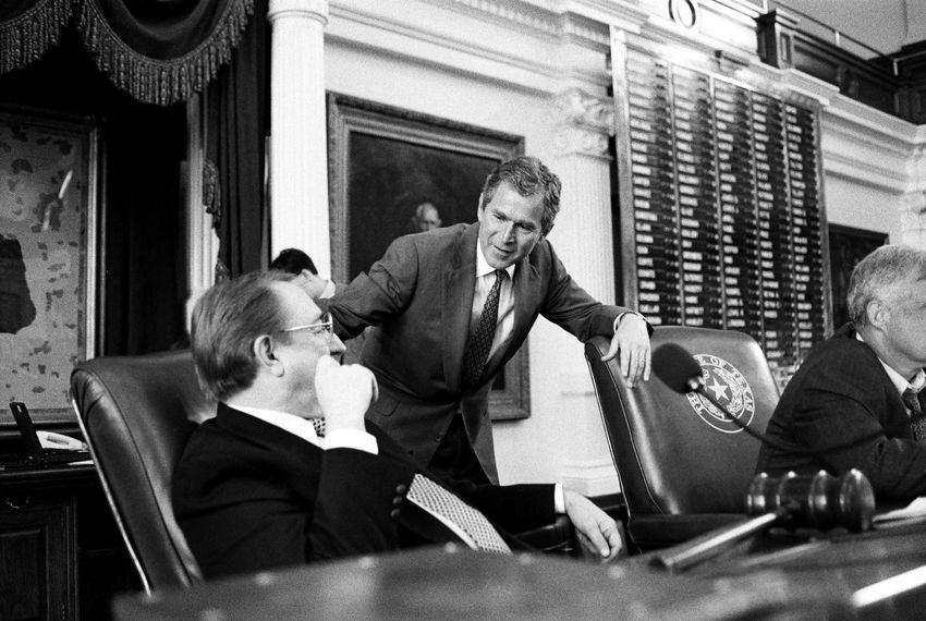 Gov. George W. Bush talks with House Speaker Pete Laney on the dais in the Texas House.