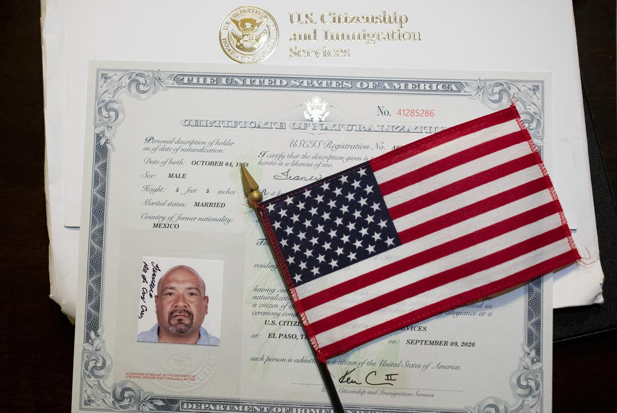 Navy Veteran Frank De La Cruz's flag and U.S. Naturalization Certificate he received after becoming a citizen last week. De La Cruz was deported to Mexico after being arrested more than a decade ago. Sept. 17, 2020.