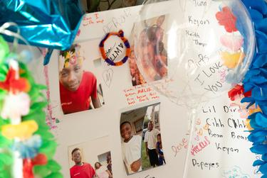 Friends and family wrote messages and left mementos in memorial of Malik Tyler, 13. He was killed at the beginning of June by a stray bullet while walking to a convenience store with a friend.