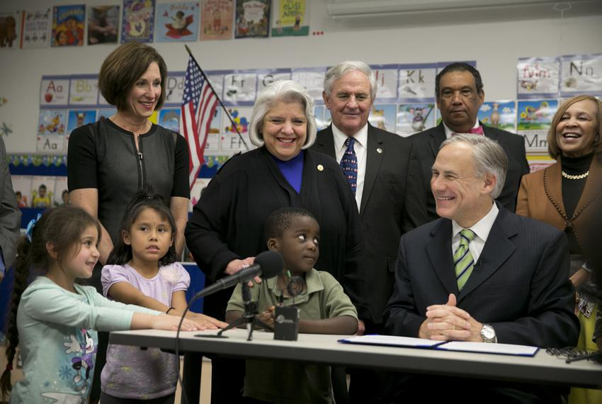 Gov. Greg Abbott signs HB4, which adds funding for pre-K, into law at the Anita Uphaus Early Childhood Center in Austin Texa…