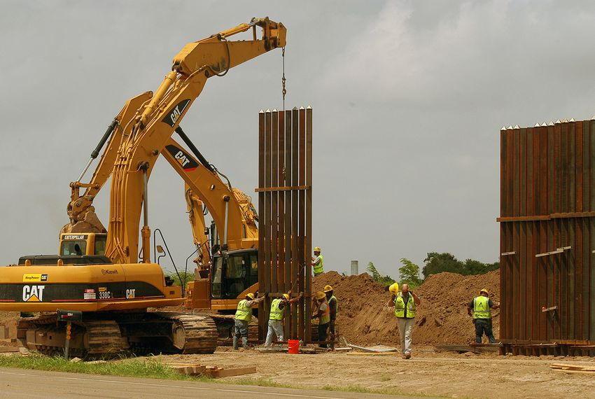 A construction crew works to erect a portion of the border wall south of Brownsville.