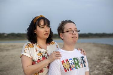 Trish and her 12-year-old son look out into the sunset at Canyon Lake on April 13, 2021.