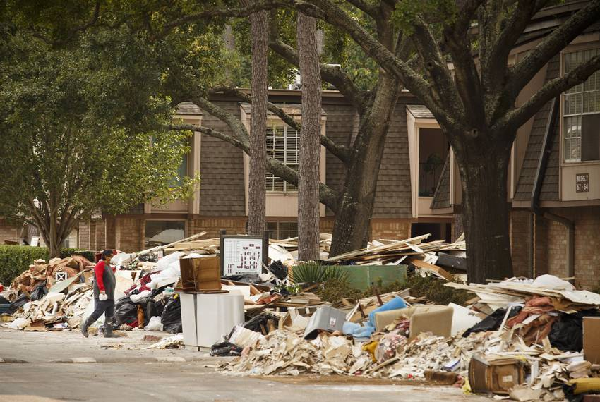 Debris from Hurricane Harvey is piled high at the Pines Condominiums near the Buffalo Bayou in the Memorial area of Houston on Sept. 13, 2017.