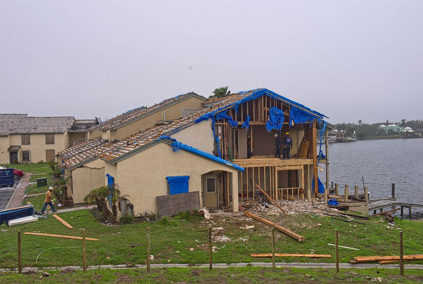 Workers in Rockport repair waterfront condominiums damaged by Hurricane Harvey on Feb. 22, 2018.