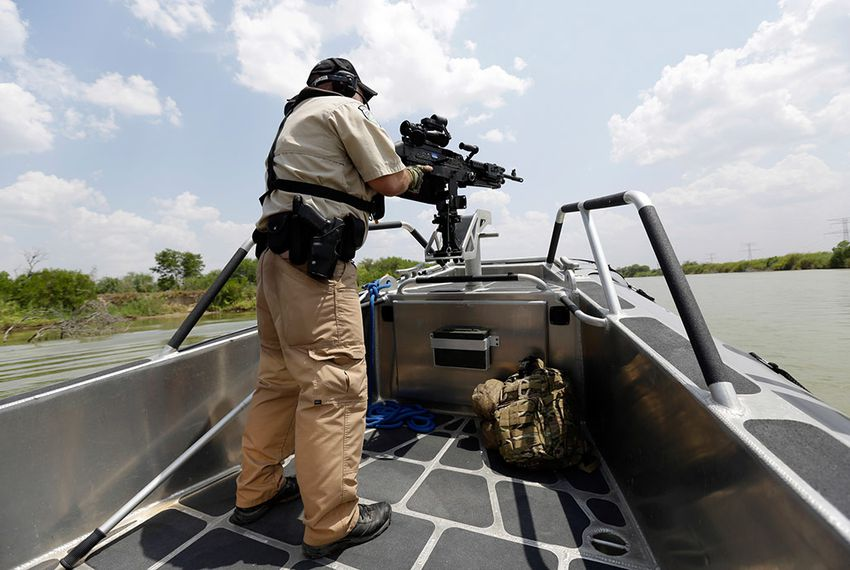 A Texas Parks and Wildlife warden patrols the Rio Grande in July, 2014.