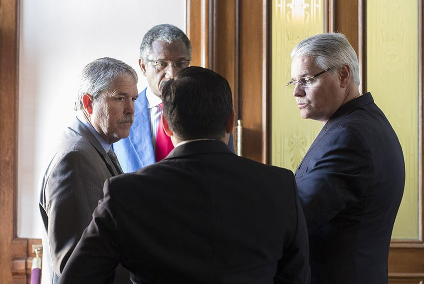 State Sen. Larry Taylor, R-Friendswood (l.), chairman of the Senate Education Committee, and Rep. Dan Huberty, R-Houston (r.), chairman of the House Public Education committee, talk with Rep. Harold Dutton, D-Houston (facing), and Rep. Diego Bernal, D-San Antonio (back), on May 27, 2017.