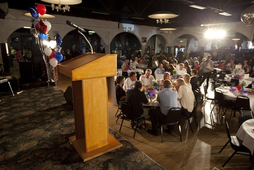 Republican diners await the arrival of the candidates at Waterloo's Electric park Ballroom on August 14, 2011.