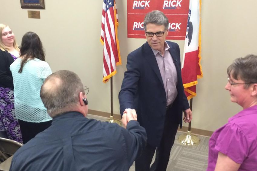 Former Gov. Rick Perry shakes hands at a Cedar Rapids event kicking off a five-day swing through Iowa in May.