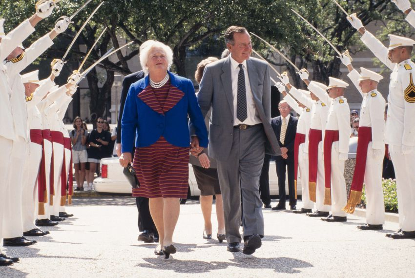 Former President George H.W. Bush and his wife Barbara review the Ross Volunteers at Texas A&M University in College Station on Sept. 10, 1997.