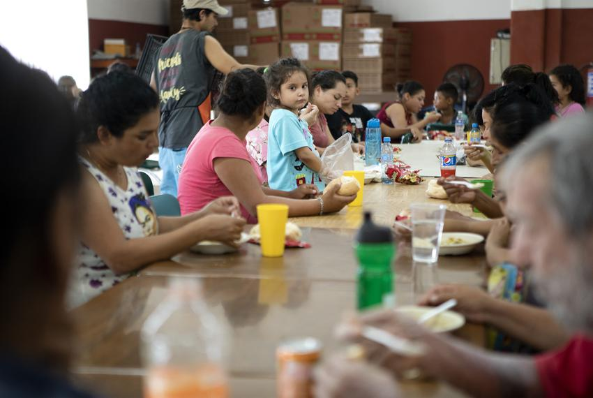 A young girl stands on a chair in the dining hall at Casa INDI on Aug. 5, 2019. The Mexican government has been busing mig...