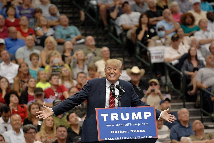 Republican Presidential contender Donald Trump speaks to a crowd of supporters at American Airlines Center in Dallas on Sept…
