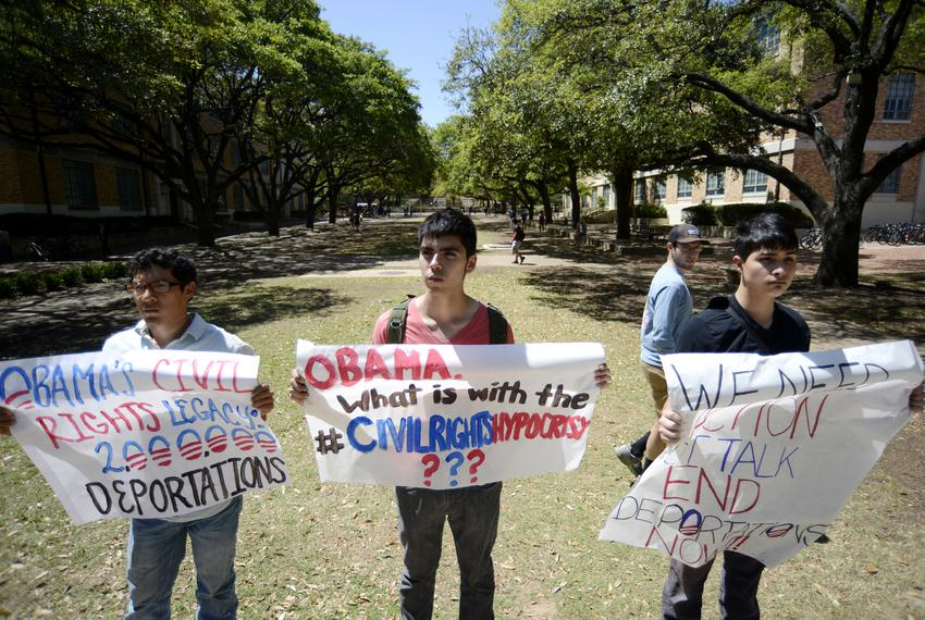 From left, immigration rights activists Manuel Ramirez, Lucian Villasenor and Adrian Orozco protest President Obama's Civil …