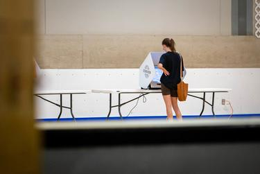 A voter casts their ballot at the Parque Zaragoza Recreation Center in Austin on the first day of early voting on Oct. 13, 2020. Voters are able to cast their ballots early until Oct. 30, 2020.