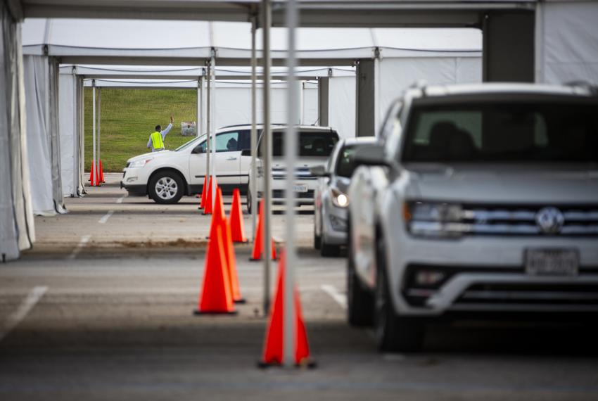 Cars lined up to vote in the drive-thru line at NRG Stadium in Houston during the first day of early voting on Oct. 13, 2020.