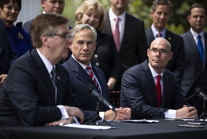 Lt. Gov. Dan Patrick (left), Gov. Greg Abbott and House Speaker Dennis Bonnen are joined by state legislators at a press conference at the Governor's Mansion.