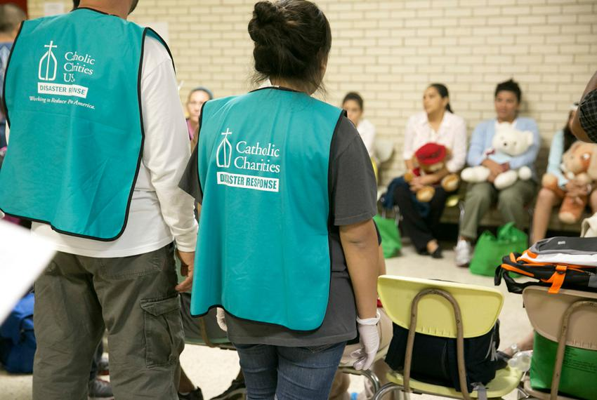 On June 24, 2014, volunteers gather at Sacred Heart Catholic Church in McAllen, where the Rio Grande Valley Catholic Chari...