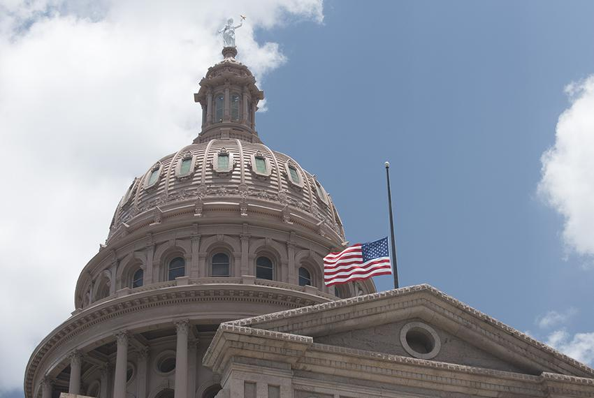 The U.S. flag flies at half-mast over the Texas Capitol in Austin July 8, 2016 following overnight violence in Dallas that...