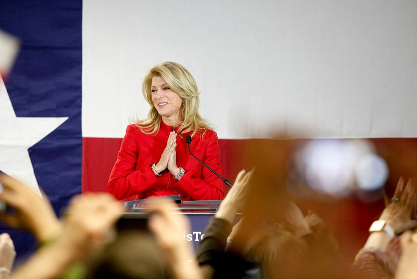 State Sen. Wendy Davis, D-Fort Worth, takes the stage as supporters at her Fort Worth headquarters cheer her victory in the …