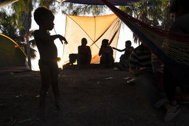 Mexican nationals pass time in an encampment in Matamoros, Tamaulipas,  as they wait their turn to seek asylum in the U.S. Oct. 13, 2019.