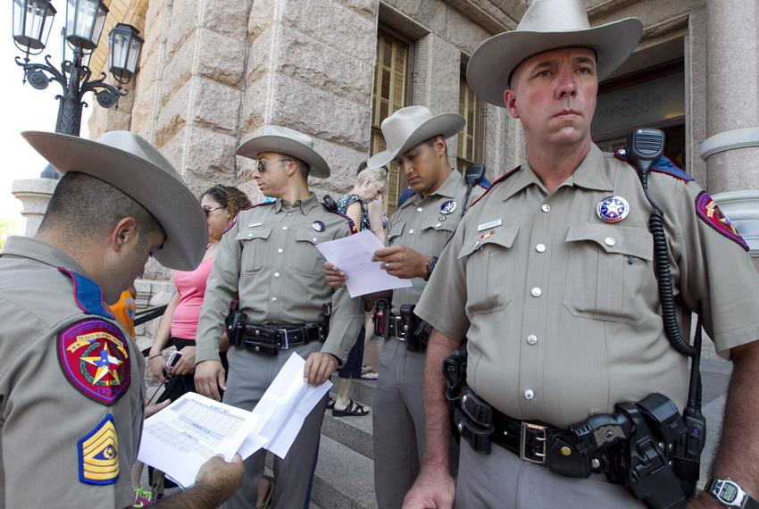 DPS officers guard the Texas Capitol's south entrance during a massive rally on SB 5 on July 1, 2013.