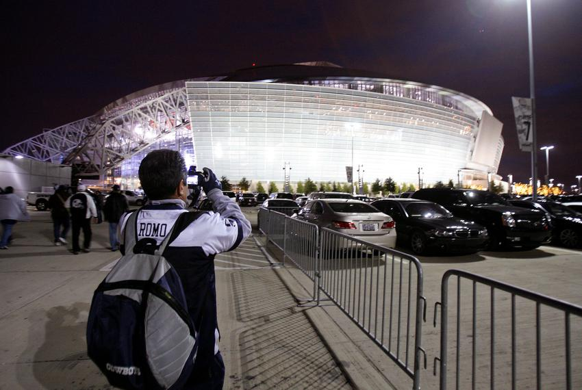 Mexican Dallas Cowboys fan Guillarmo Amieva of Mexico City snaps a picture of Cowboys Stadium while on a tour from Monterrey…