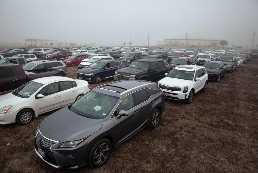 Rows of cars at the Rio Grande Valley Livestock Show Grounds. Area residents lined up early in the morning for the COVID-19 …