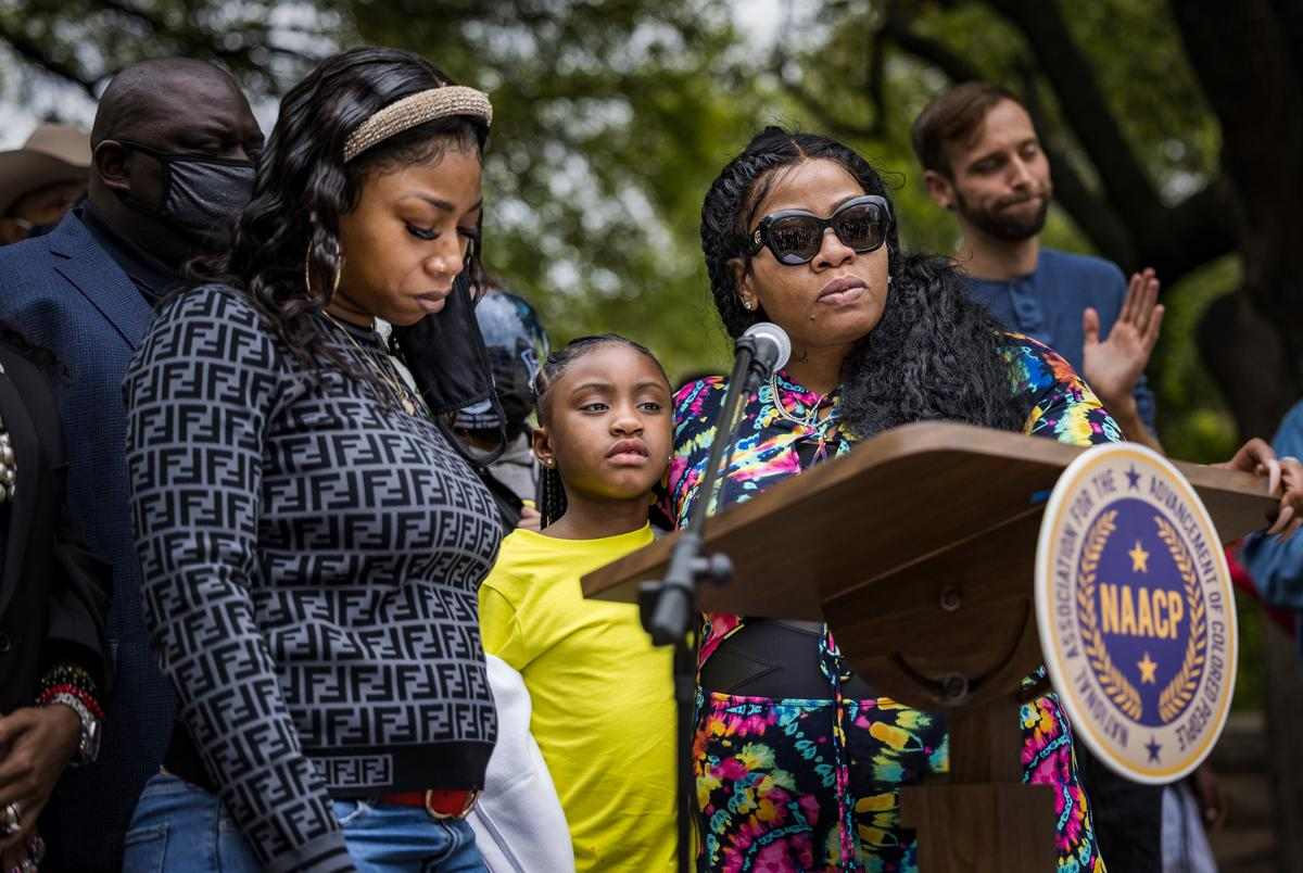 From left: Family members of George Floyd, sister Bridgett Floyd, daughter Gianna Floyd, and the mother of Floyd's daughter, Roxie Washington, speak at a rally at the Texas Capitol in support of a sweeping police reform bill known as the George Floyd Act on April 3, 2021.